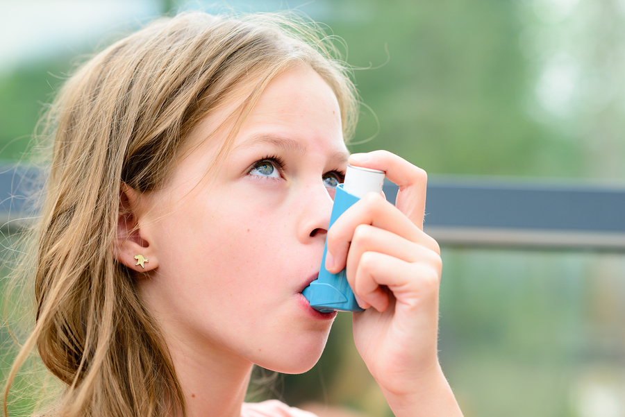 bigstock Pretty Girl Using Asthma Inhal 119293265