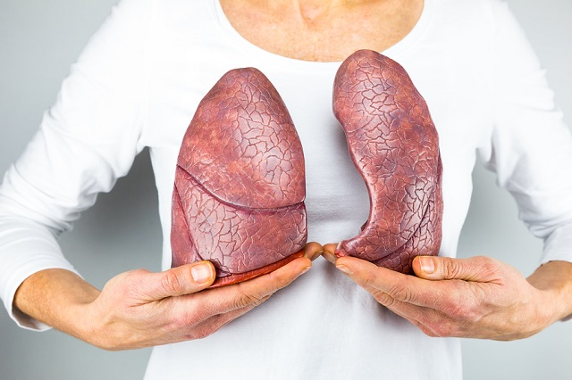 bigstock Woman showing two lungs in fro 86891879