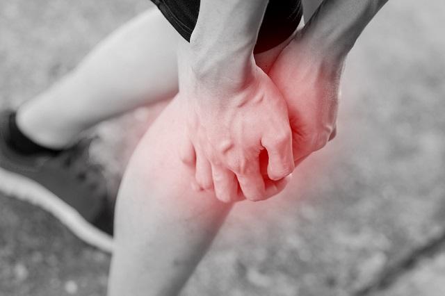 bigstock Runner Touching Painful Knee 115834556